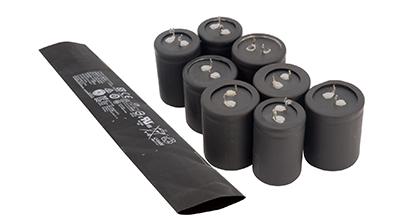 RSFR-(2X)125HEC——電池電容專用無鹵阻燃聚烯烴熱縮套管  電池電容專用無鹵阻燃熱縮管由輻射交聯聚烯烴材料構成,理化電氣性能優異,壁厚超薄,硬度高,易穿管,主要應用于電池及電容器上,起到絕緣防護的作用,可完全替代PVC套管及PET套管使用。